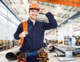 15271577-Portrait-of-an-happy-worker-in-a-factory-Stock-Photo-construction